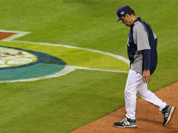 Joe Torre trudges away after failing his country, like he always does.
