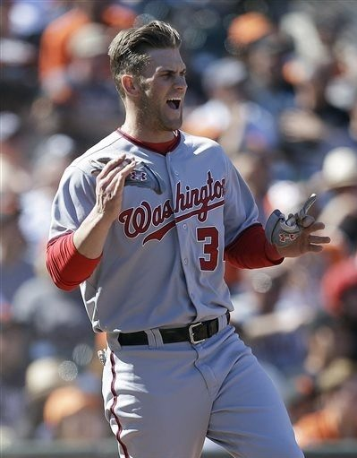 "Bryce Harper celebrates scoring the go-ahead run in the 10th inning of game three by singing every aria from Mozart's ""Don Giovanni"" in succession. (AP Photo/Ben Margot)"