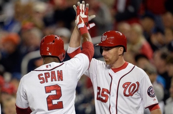 Denard Span makes the mistake of looking into the fiery pools of unbridled hatred that are Adam LaRoche's eyes. (Patrick McDermott/Getty Images)